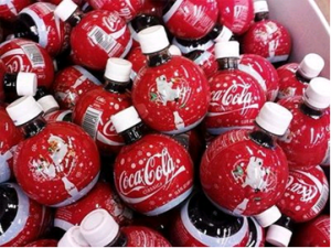 Coca-Cola holiday bottles look like ornaments.