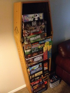 a collection of game boxes in a coffin-like container
