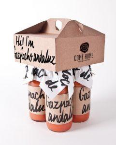 Custom boxes holding gazpacho